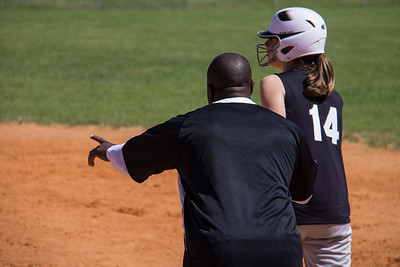 Jessica gets some last minute pointers from Coach Bryant