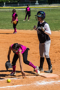 Rylee retreats back to the bag after drawing a throw from the catcher