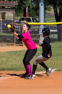 Jasmine beats the throw to third base