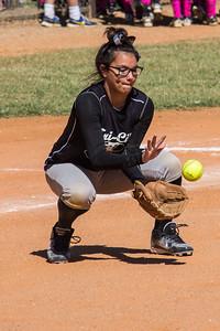 Jasmine cradles the ball at third base