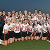 North Andover lacrosse players pose with the trophy after defeating Winchester in the D1 North Final in North Andover.