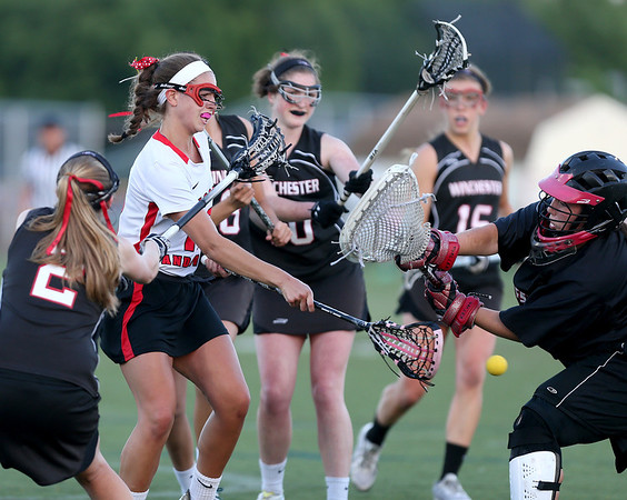 North Andover's Leah Chittick scores past Winchester defense and goalie Hallie Stone.