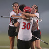 North Andover players Abbie Karalis, left, and Emily Sauls, right, celebrate with goalie Lauren Hiller.