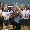 North Andover players congratulate goalie Lauren Hiller after defeating Winchester in the D1 North Lacrosse Final.