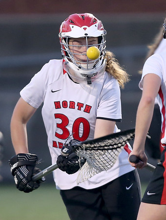 North Andover goalie Lauren Hiller keeps her eye on the ball as she makes a save.