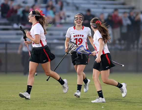 North Andover's Emily Sauls (19) celebrates with teammates after North Andover scored a goal.
