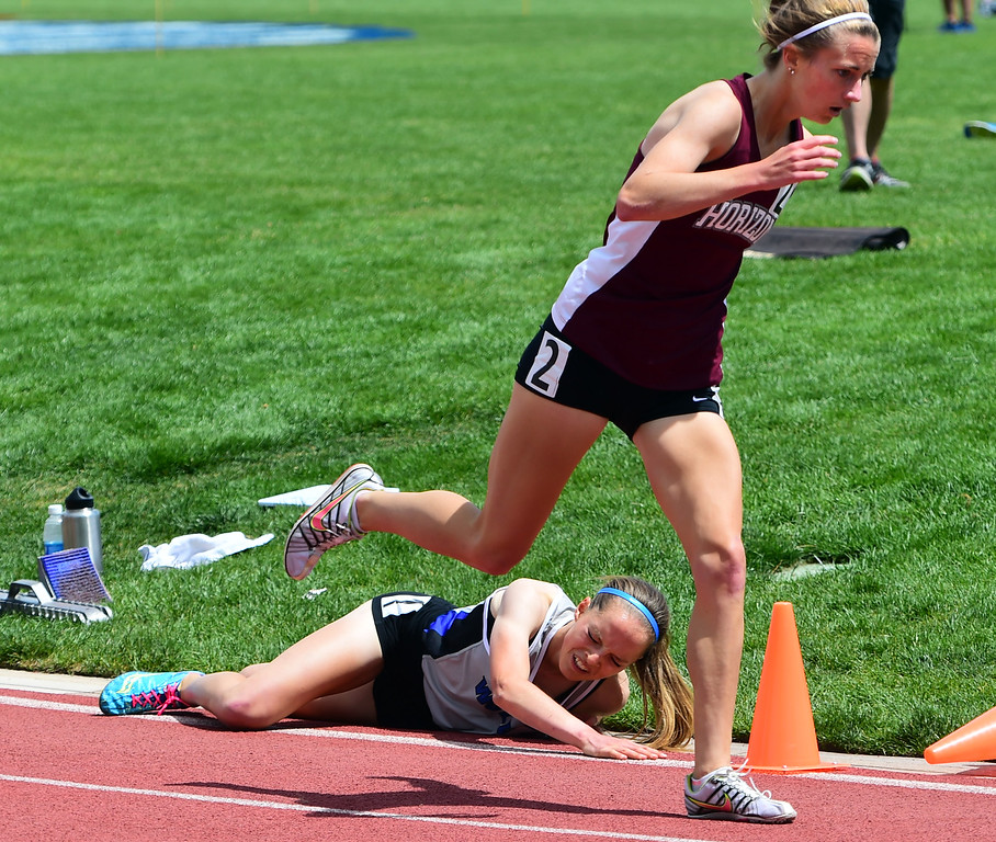 . Brie Oakley, of Grandview, falls down in the 1600 meters, Megan Moody, of Horizon, make contact in the fall and was disqualified during the Colorado State Track and Field Championships on Saturday  at Jeffco Stadium. For more photos, go to www.bocopreps.com. Cliff Grassmick  Staff Photographer  May 21, 2016