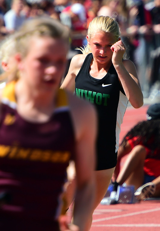 . Alexis Carroll, of Niwot, runs the first leg of a relay during the Colorado State Track and Field Championships on Saturday at Jeffco Stadium. For more photos, go to www.bocopreps.com. Cliff Grassmick  Staff Photographer  May 21, 2016