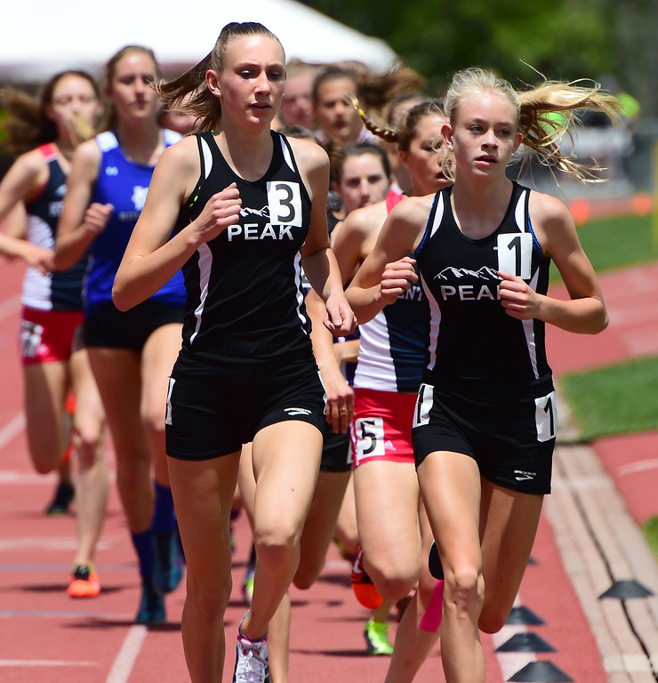 . Quinn McConnell, left, and Anna Shults, compete in the 1600 meters during the Colorado State Track and Field Championships on Saturday at Jeffco Stadium. For more photos, go to www.bocopreps.com. Cliff Grassmick  Staff Photographer  May 21, 2016
