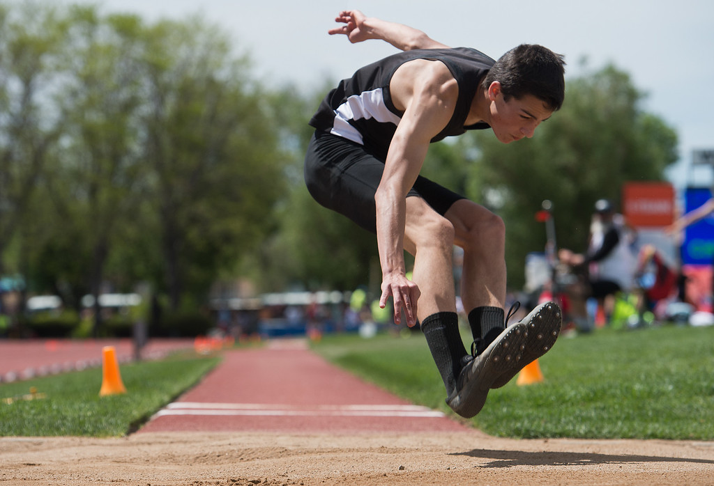 . Jefferson Academy\'s Tyler Thimsen competes in the boys 3A long jump during the Track and Field State Championships at Jefferson County Stadium in Lakewood on Saturday. More photos: www.BoCoPreps.com Autumn Parry/Staff Photographer May 21, 2016