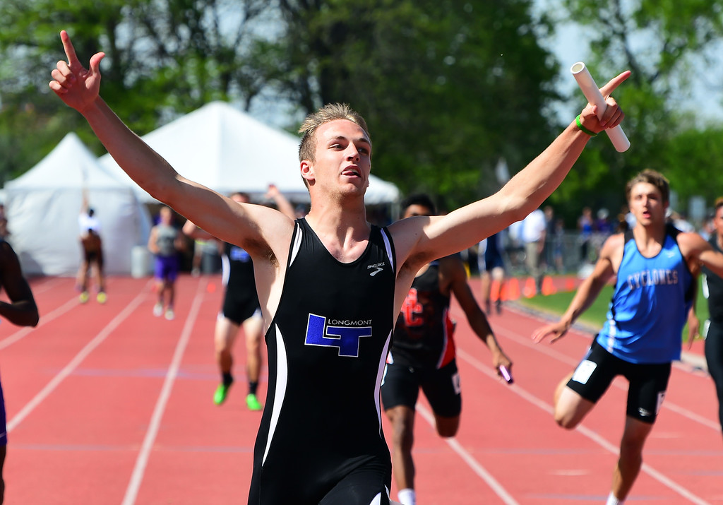. Trevor Cook, of Longmont, helps his team win the 4X100 meter relay during the Colorado State Track and Field Championships on Saturday at Jeffco Stadium. For more photos, go to www.bocopreps.com. Cliff Grassmick  Staff Photographer  May 21, 2016