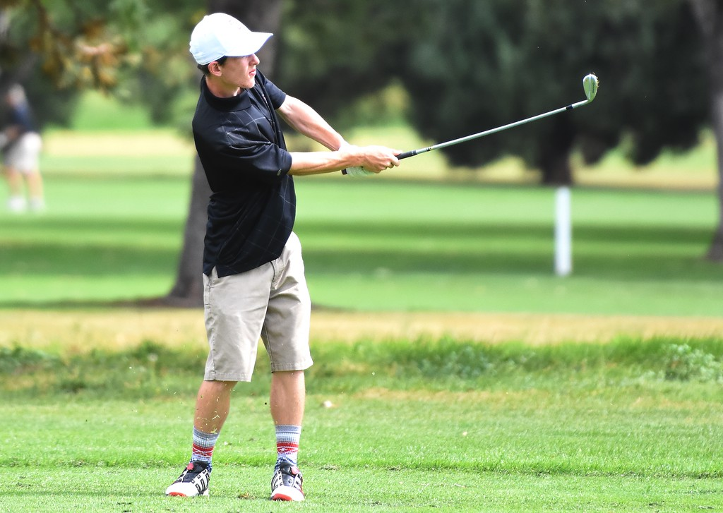 . Silver Creek\'s David Brett hits an approach shot during the 4A Region 3 tournament on Wednesday at the Olde Course in Loveland.