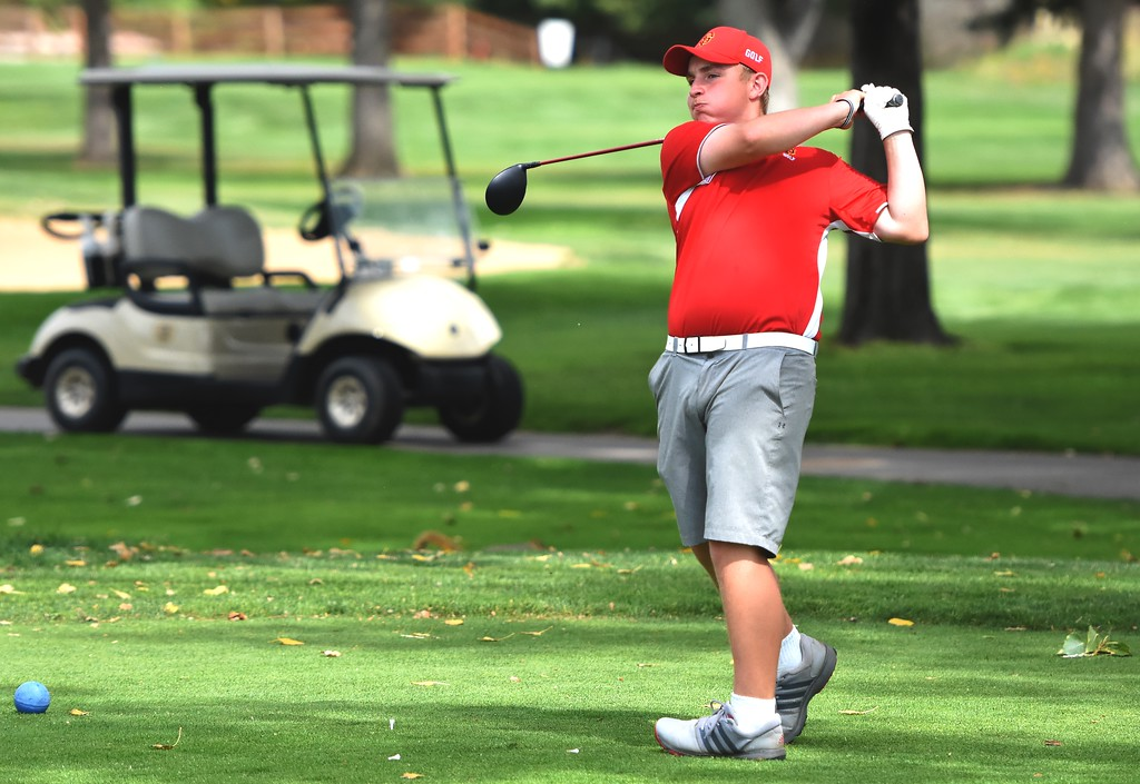 . Skyline\'s Brady Hindman hits a tee shot during the 4A Region 3 tournament on Wednesday at the Olde Course in Loveland.