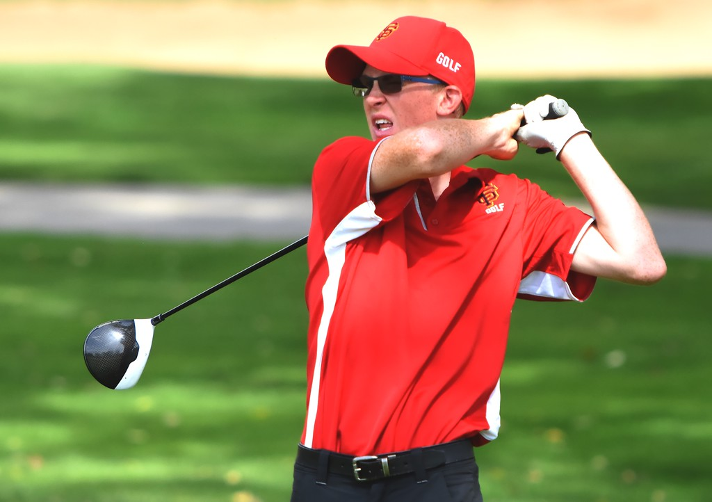 . Skyline\'s John Reed hist a tee shot on No. 11 during the 4A Region 3 tournament on Wednesday at the Olde Course in Loveland.