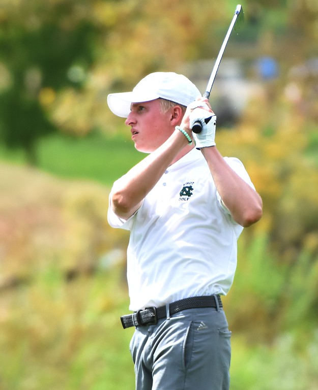 . Niwot\'s Andrew Elliott watches a tee shot on No. 18 during the 4A Region 3 tournament on Wednesday at the Olde Course in Loveland.