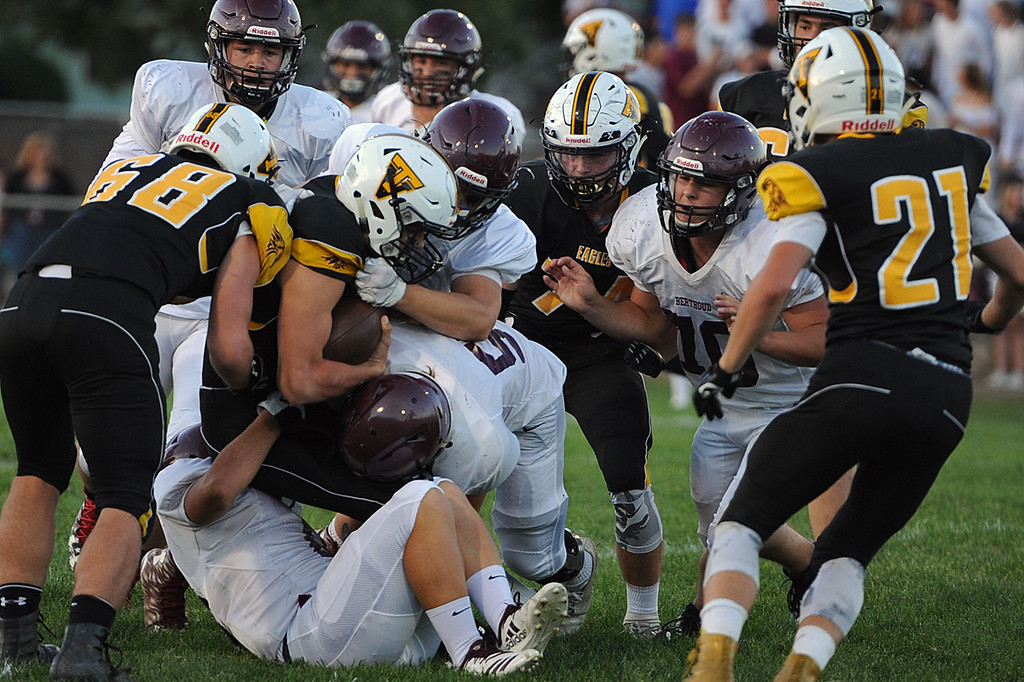 . A swarm of Berthoud defenders tackle Thompson Valley\'s Cameron Nellor during a game Friday, Sept. 14, 2018 at Patterson Stadium in Loveland, Colorado. (Sean Star/Loveland Reporter-Herald)
