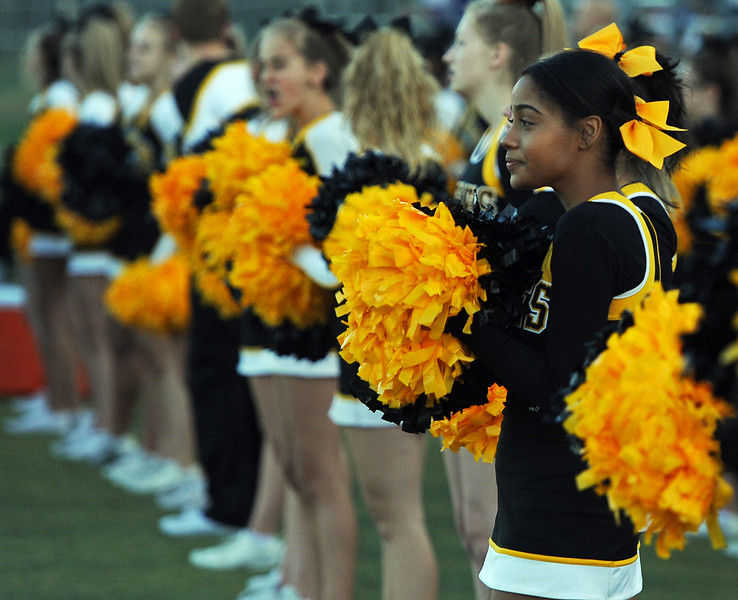 Thompson Valley cheerleaders wait for the start of a game against Berthoud on Friday, Sept. 14, 2018 at Patterson Stadium in Loveland, Colorado. (Sean Star/Loveland Reporter-Herald)