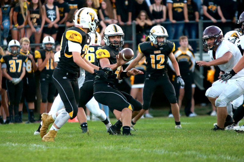 Thompson Valley's (4) Cam Nellor, is mid-pass to his teammate, (21) Aden Schaffer while (12) Dominic Lobello covers them at Patterson stadium at their game against Berthoud High school on Sept. 14, 2018. <br /> (Photo by Taelyn Livingston/ Loveland Reporter-Herald)
