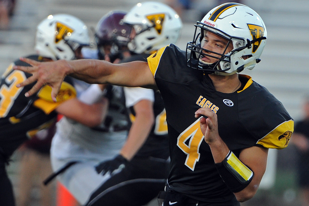 . Thompson Valley\'s Cameron Nellor follows through on a pass during a game Friday, Sept. 14, 2018 at Patterson Stadium in Loveland, Colorado. (Sean Star/Loveland Reporter-Herald)