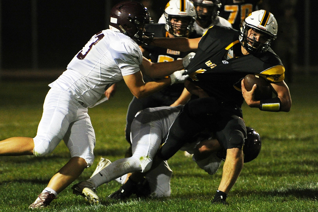 . Thompson Valley\'s Cameron Nellor tries to break free from a tackle by Berthoud\'s Cooper Hidalgo during a game Friday, Sept. 14, 2018 at Patterson Stadium in Loveland, Colorado. (Sean Star/Loveland Reporter-Herald)