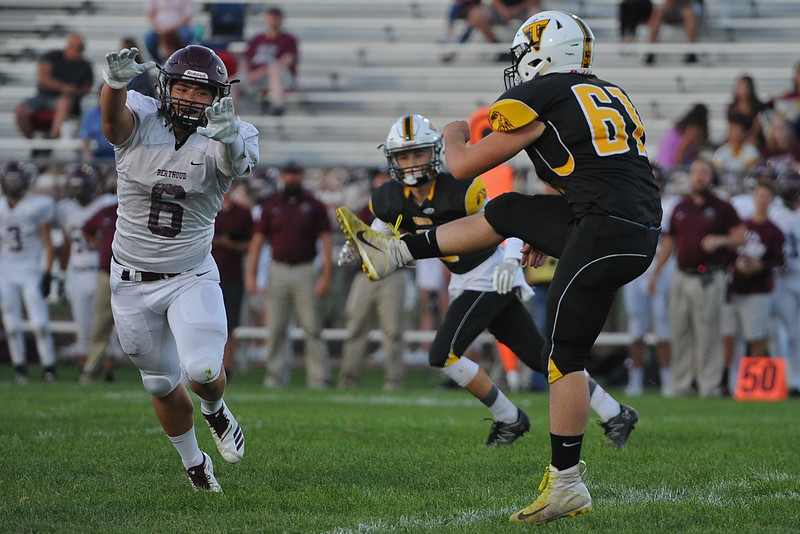 Berthoud's Anthony Trojahn (6) goes to block a punt by Thompson Valley during a game Friday, Sept. 14, 2018 at Patterson Stadium in Loveland, Colorado. (Sean Star/Loveland Reporter-Herald)