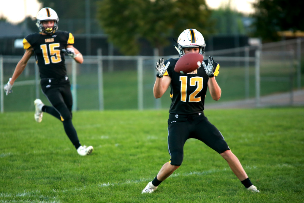 . Thompson Valley�s (12) Dominic Lobello, is focused on the ball right before the catch while his teammate (15) Trey Kreikemeier is close behind in the Friday night game against the Berthoud Spartans on Sept. 14, 2018 in Loveland at Patterson stadium.(Photo by Taelyn Livingston/ Loveland Reporter-Herald)