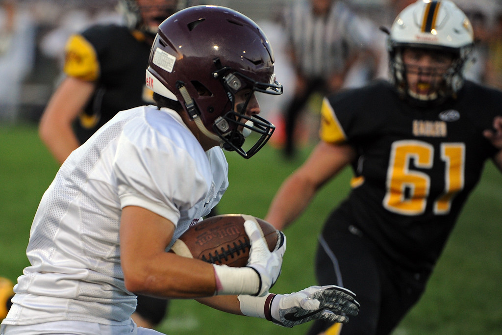 . Berthoud\'s Danny Pelphrey looks for running room during a game Friday, Sept. 14, 2018 at Patterson Stadium in Loveland, Colorado. (Sean Star/Loveland Reporter-Herald)