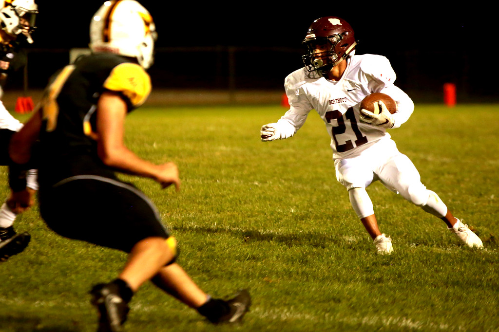 . Berthoud High School�s (21) Miguel Sarmiento, looks for a clear path in Friday night�s game against the Thompson Valley Eagles on Sept. 14, 2018 at Patterson Stadium in Loveland.(Photo by Taelyn Livingston/ Loveland Reporter-Herald)