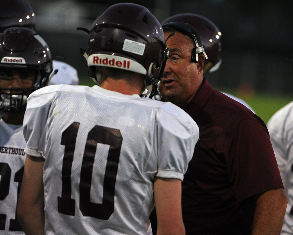 . Berthoud head coach Troy Diffendaffer talks to Brennen Garvin during a game Friday, Sept. 14, 2018 at Patterson Stadium in Loveland, Colorado. (Sean Star/Loveland Reporter-Herald)
