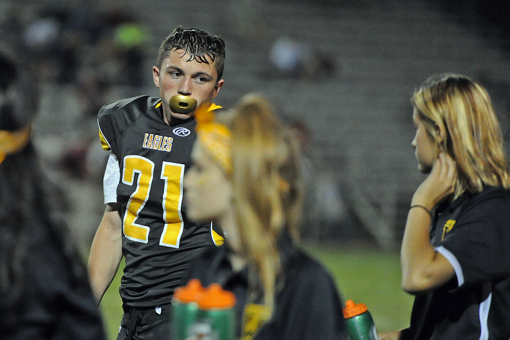. Thompson Valley\'s Aden Shaffer grabs a drink during a game Friday, Sept. 14, 2018 at Patterson Stadium in Loveland, Colorado. (Sean Star/Loveland Reporter-Herald)