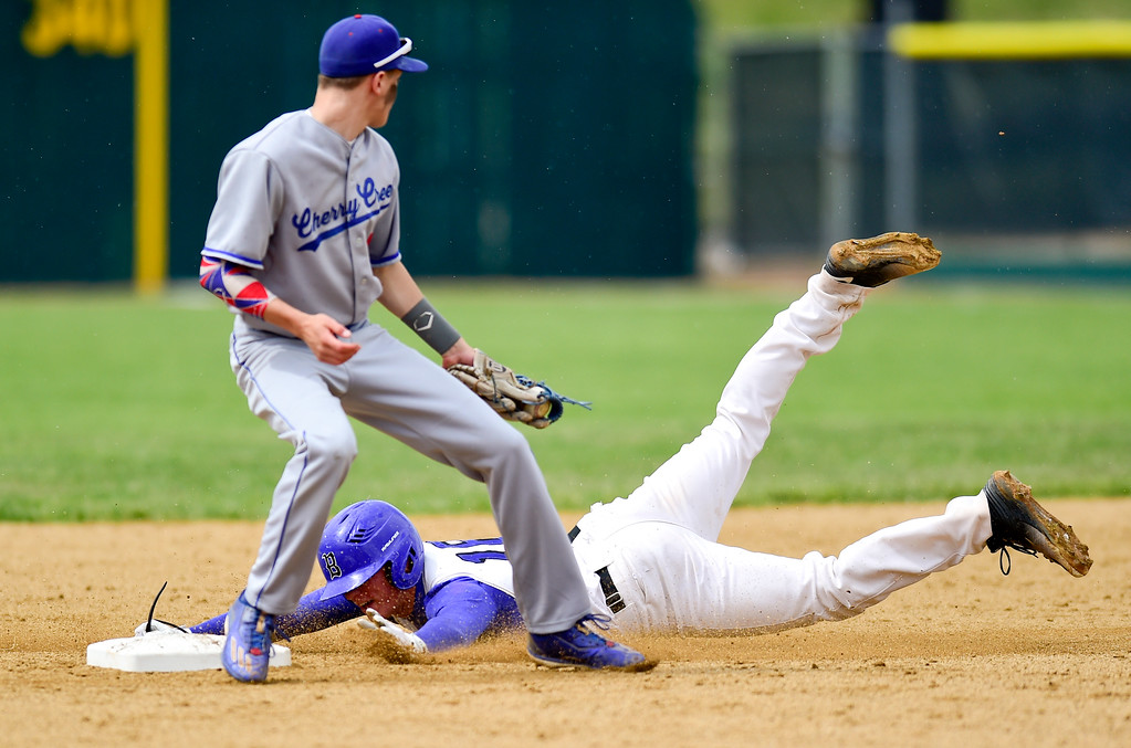 . Broomfield High School\'s Tanner Garner (No. 16) slides safely into second as Cherry Creek High School\'s Brice Martinez (No. 5) tries to make the tag on Saturday. The Eagles defeated the Bruins, 2-1, to advance to the final game. More photos: BoCoPreps.com. Matthew Jonas/Staff Photographer May 27,  2017