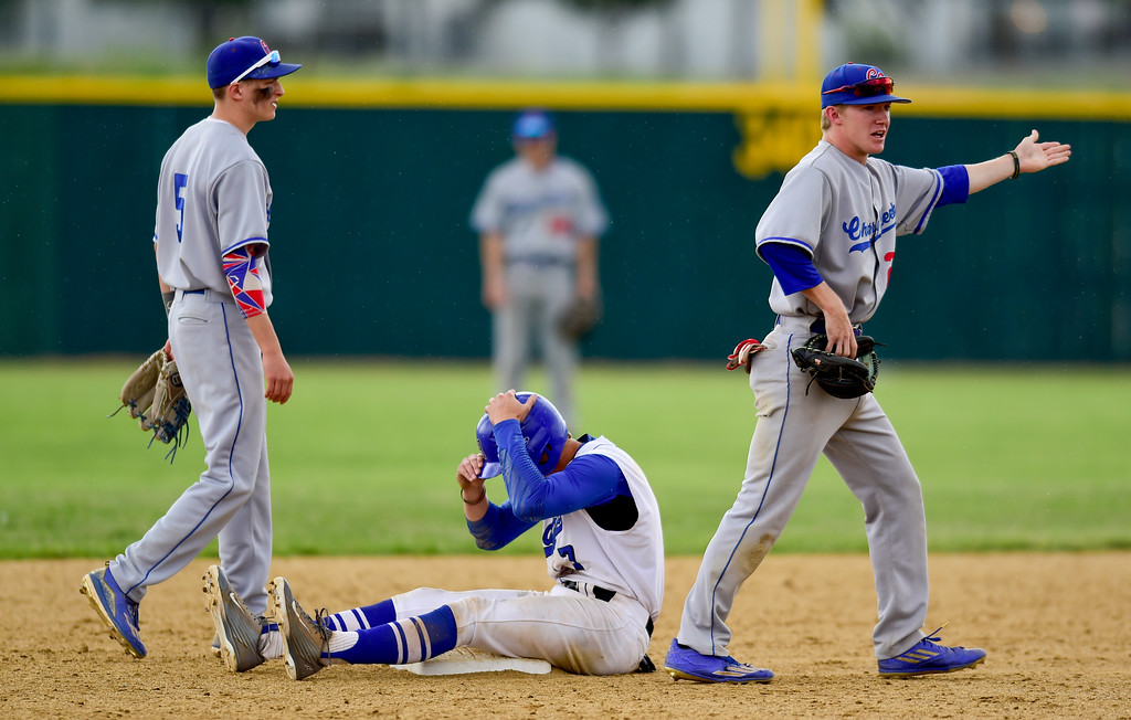 . Cherry Creek High School\'s Cody Schultz (No. 22) argues the call after tagging Broomfield High School\'s Josh Cox (No. 7) in the face on Saturday. The Eagles defeated the Bruins, 2-1, to advance to the final game. More photos: BoCoPreps.com. Matthew Jonas/Staff Photographer May 27,  2017