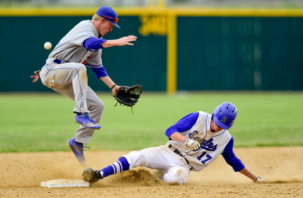 . Broomfield High School\'s Matt Turner (No. 17) slides into second as the ball gets past Cherry Creek High School\'s Cody Schultz (No. 22) on Saturday. The Eagles defeated the Bruins, 2-1, to advance to the final game. More photos: BoCoPreps.com. Matthew Jonas/Staff Photographer May 27,  2017