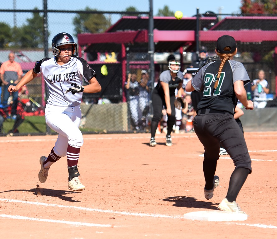 . Silver Creek�s Kayla Harper races down the line to beat out a throw at first base during the softball state championships on Friday at Aurora Sports Park. (Photo by Brad Cochi/BoCoPreps.com)