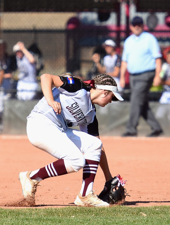 . Silver Creek second baseman Emma Flynn fields a ground ball during the softball state championships on Friday at Aurora Sports Park. (Photo by Brad Cochi/BoCoPreps.com)