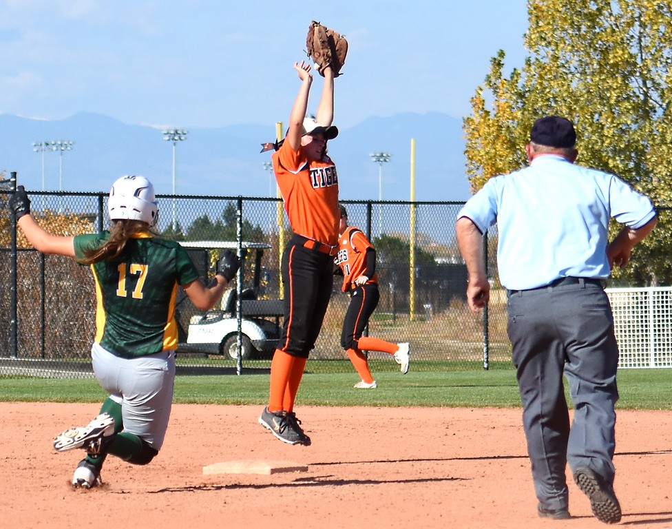 . Erie�s Morgan Weber makes a leaping grab during the softball state championships on Friday at Aurora Sports Park. (Photo by Brad Cochi/BoCoPreps.com)