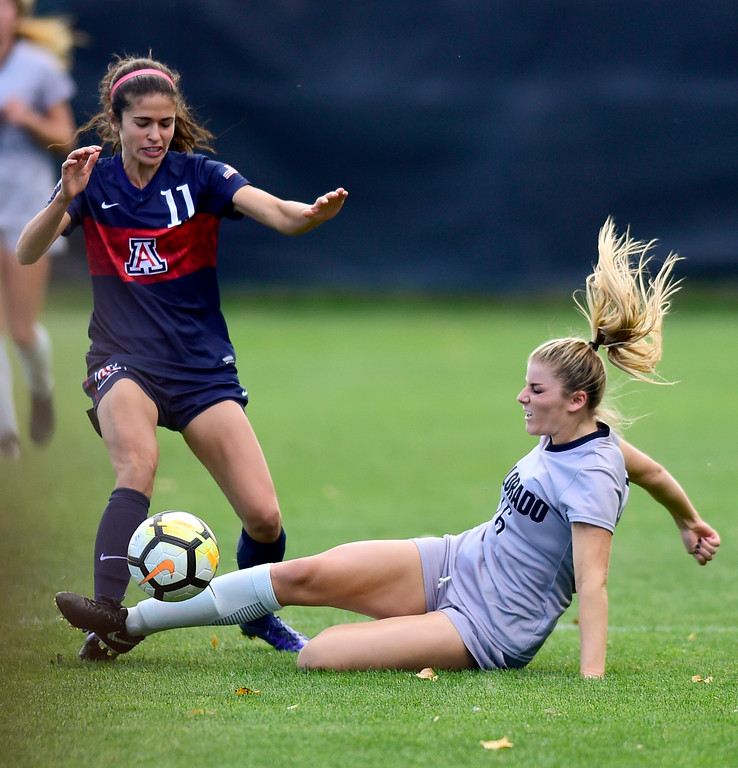 . University of Colorado Erin Greening (No. 16) tries to knock the ball away from University of Arizona Morgan McGarry (No. 11) at Prentup Field in Boulder, Colorado on Oct. 22, 2017. (Photo by Matthew Jonas/Times-Call)