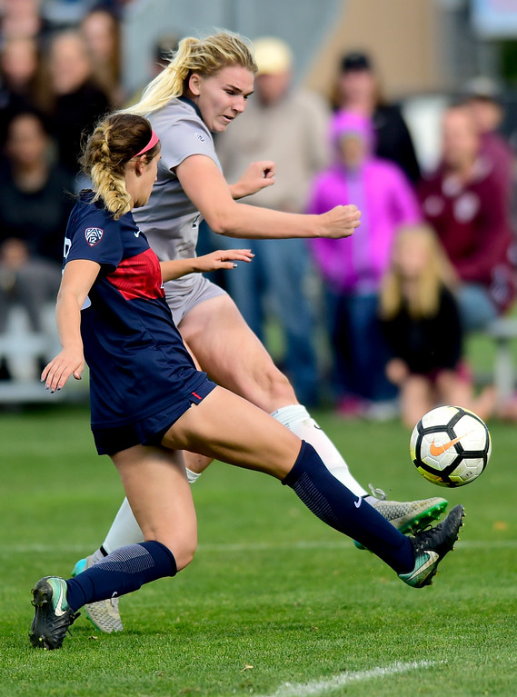 . University of Colorado Taylor Kornieck (No. 22) takes a shot on goal while pressured by University of Arizona Samantha Falasco (No. 23) at Prentup Field in Boulder, Colorado on Oct. 22, 2017. (Photo by Matthew Jonas/Times-Call)