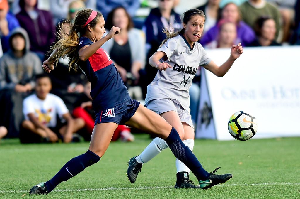 . University of Colorado Becca Rasmussen (No. 14) battles with University of Arizona Sabrina Enciso (No. 16) at Prentup Field in Boulder, Colorado on Oct. 22, 2017. (Photo by Matthew Jonas/Times-Call)