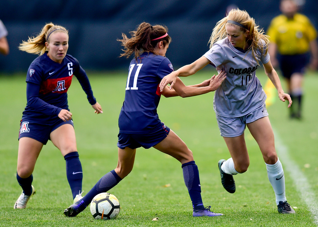 . University of Colorado (No. 10) is pressured by University of Arizona Morgan McGarry (No. 11) and Tia Painilainen (No. 5) at Prentup Field in Boulder, Colorado on Oct. 22, 2017. (Photo by Matthew Jonas/Times-Call)