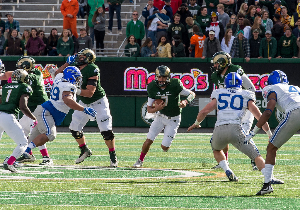 . Colorado State quarterback Nick Stevens (7) runs for a short first down against Air Force Saturday afternoon Oct., 28, 2017 at the CSU Stadium in Fort Collins. (Michael Brian/For the Reporter-Herald)