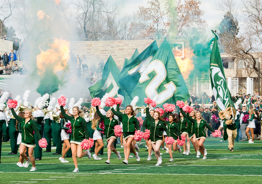 . Colorado State cheerleaders and CAM the RAM lead the football team onto the field to face Air Force Saturday afternoon Oct., 28, 2017 at the CSU Stadium in Fort Collins. (Michael Brian/For the Reporter-Herald)