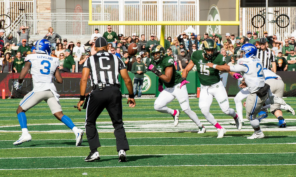 . Colorado State linebacker Kiel Robinson (15) forces the option pitch by Air Force quarterback Arion Worthman (2) Saturday afternoon Oct., 28, 2017 at the CSU Stadium in Fort Collins. Air Force handily won the game, 45-28. (Michael Brian/For the Reporter-Herald)