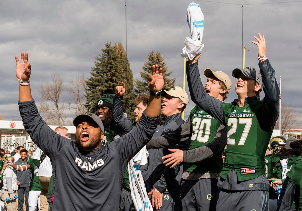 . Colorado State players try to rally the home crowd during an Air Force third-down play Saturday afternoon Oct., 28, 2017 at the CSU Stadium in Fort Collins. The Rams lost, 45-28. (Michael Brian/For the Reporter-Herald)