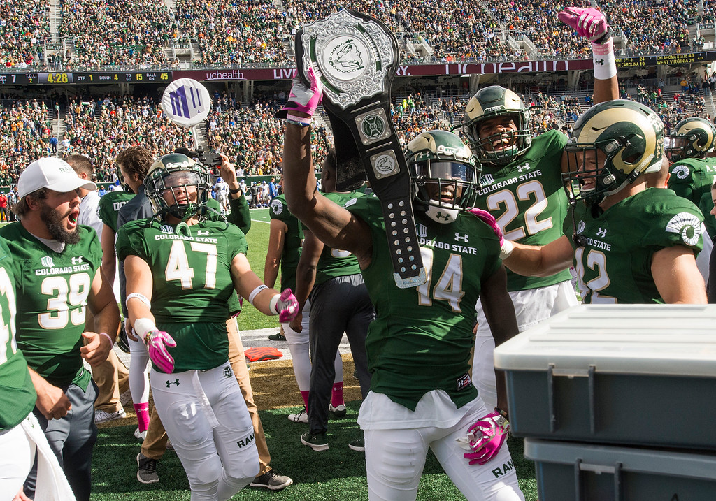 . Colorado State cornerback Anthony Hawkins (14) celebrates with the team\'s Turnover Belt after pulling in an interception against Air Force Saturday afternoon Oct., 28, 2017 at the CSU Stadium in Fort Collins. The Rams fell to the Falcons, 45-28. (Michael Brian/For the Reporter-Herald)