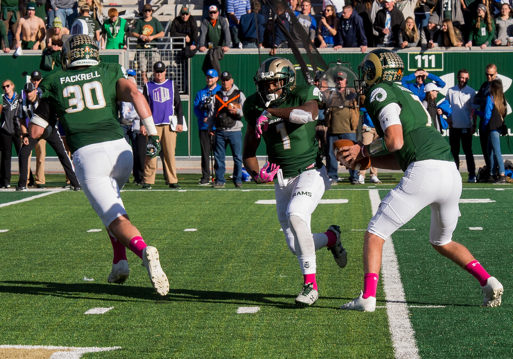 . Colorado State quarterback Nick Stevens (7) fakes the handoff to running back Dalyn Dawkins (1) against Air Force Saturday afternoon Oct., 28, 2017 at the CSU Stadium in Fort Collins. The Rams fell to the Falcons, 45-28. (Michael Brian/For the Reporter-Herald)
