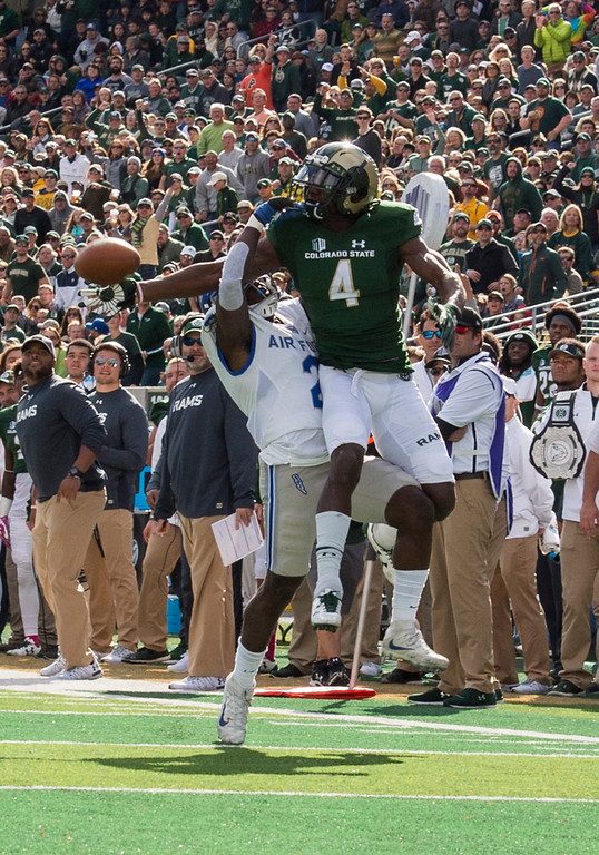 . Colorado State wide receiver Michael Gallup (4) draws a pass interference call against Air Force defensive back Marquis Griffin (2) Saturday afternoon Oct., 28, 2017 at the CSU Stadium in Fort Collins. The Rams lost, 45-28. (Michael Brian/For the Reporter-Herald)
