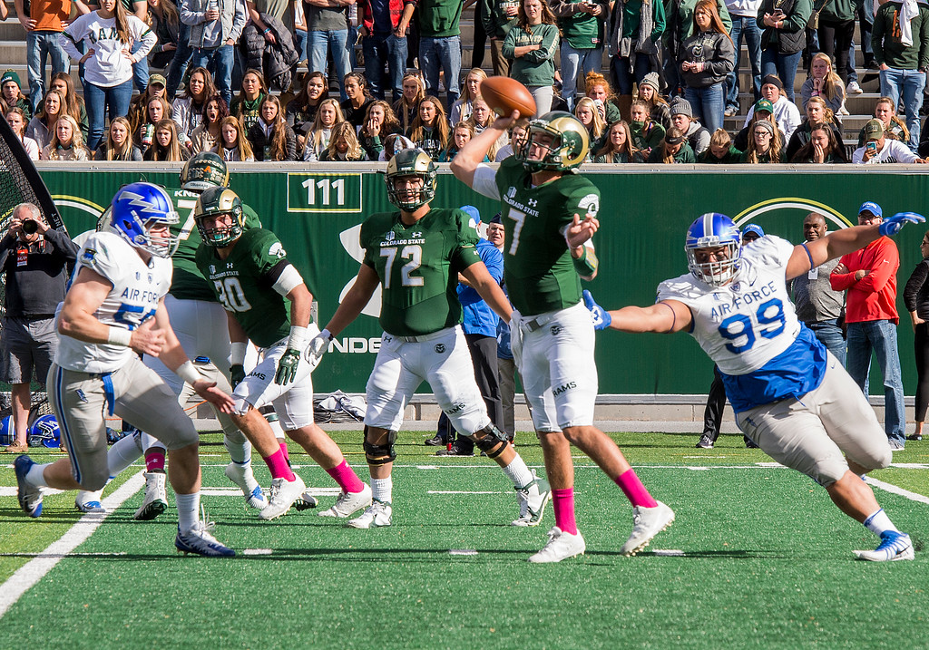 . Colorado State quarterback Nick Stevens (7) throws under pressure as Air Force defensive lineman Mosese Fifita (99) closes in Saturday afternoon Oct., 28, 2017 at the CSU Stadium in Fort Collins. The pass would be intercepted and the Rams lost, 45-28. (Michael Brian/For the Reporter-Herald)