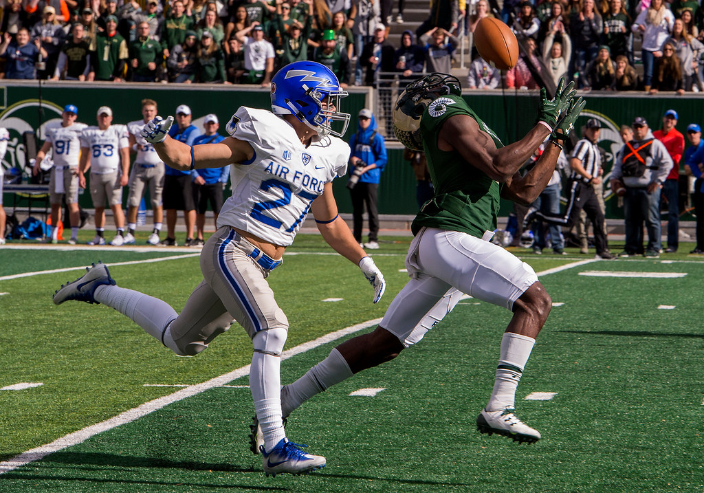 . Colorado State wide receiver Michael Gallup (4) snags a pass he would take to the end zone for a touchdown against Air Force defensive back Jeremy Fejedelem (27) in early action Saturday afternoon Oct., 28, 2017 at the CSU Stadium in Fort Collins. (Michael Brian/For the Reporter-Herald)