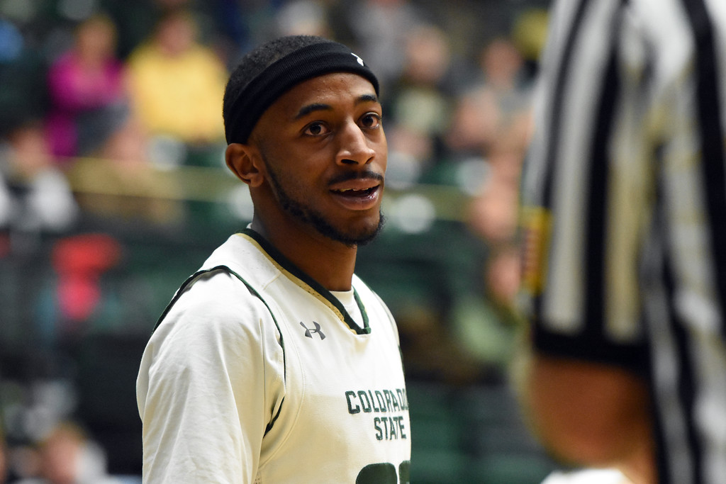 . Colorado State guard J.D. Paige talks with an official during a game February 22, 2018 at Moby Arena in Fort Collins.  (Sean Star / Loveland Reporter-Herald)